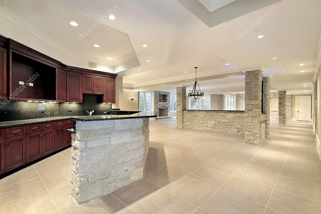 Stone bar and kitchen in basement — Stock © lmphot