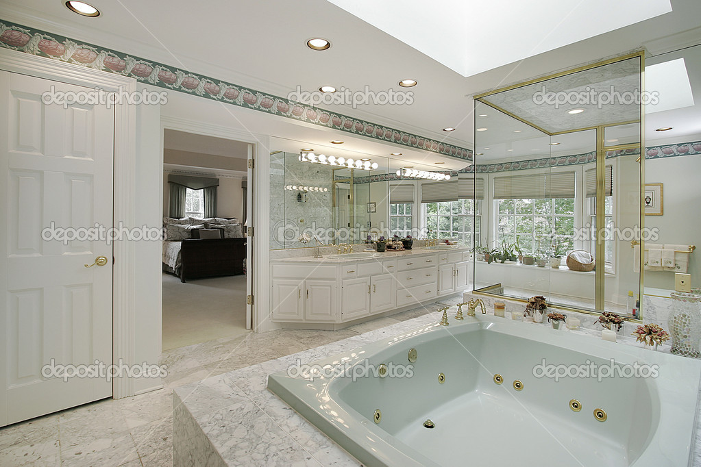 Elegant master bath with large rectangular tub  Stock Photo #8702513