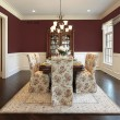 Dining room with maroon walls — Stock Photo