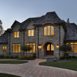 Luxury stone home at dusk — Stock Photo #8711123