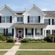 White suburban home with front porch - Stock Photo