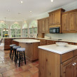 Stock Photo: Wood cabinets in kitchen with eating area