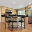 Kitchen with island and stools — Stock Photo #8716583