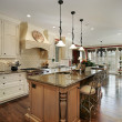 Kitchen with marble island countertop — Stock Photo #8716688