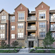 Stock Photo: Three story tudor style condominium
