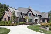 Large brick home with circular driveway — Stock Photo