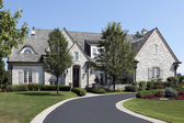 Luxury stone home with circular driveway — Stock Photo