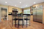 Kitchen with island and stools — Стоковое фото