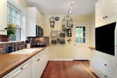Kitchen with cherry wood floors — Stock Photo