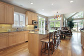 Large kitchen with oak cabinetry — 图库照片