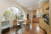 Kitchen with arched window — Stock Photo