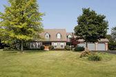 Luxury suburban brick home — Stock Photo