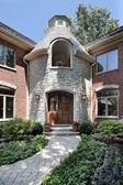 Home with circular stone entryway — Stock Photo