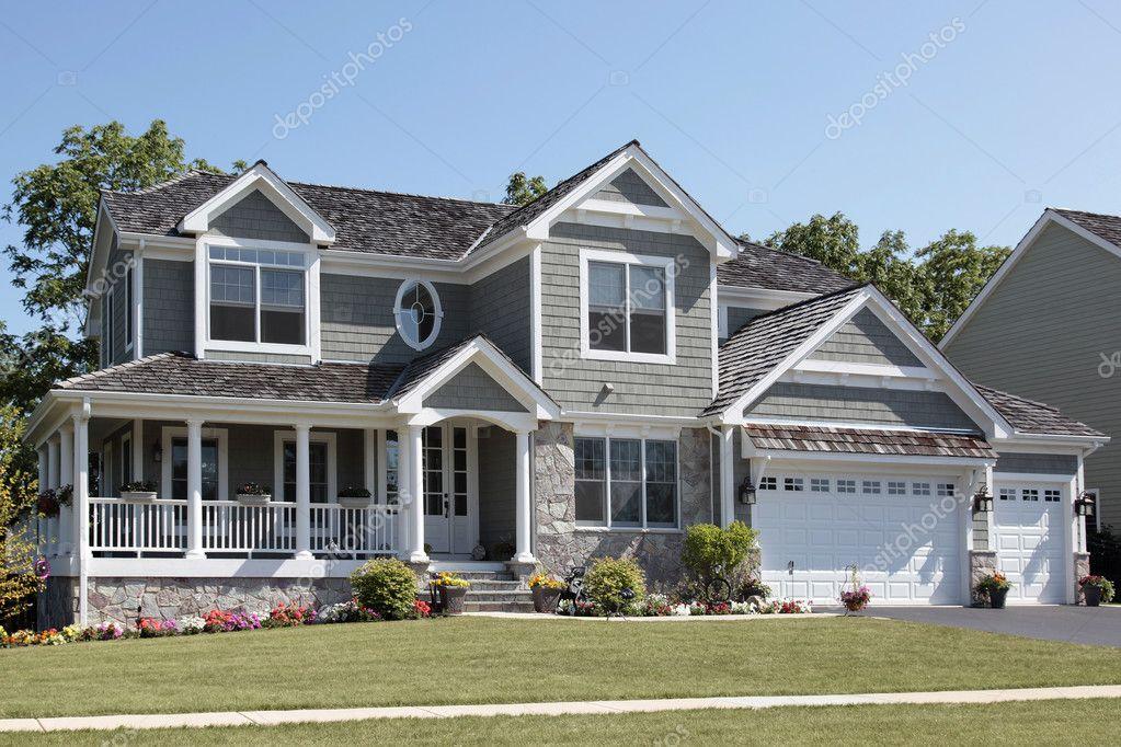 Suburban Home With Wraparound Porch Stock Photo 169 Lmphot 8711413
