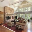 Family room with brick fireplace - ストック写真