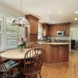 Wood cabinet kitchen and eating area — Stock Photo #8727756