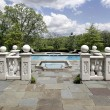 Stone patio and pool — Stock Photo
