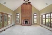 Family room with brick fireplace — Stock Photo