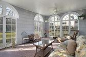 Sunroom with back yard views — Stock Photo