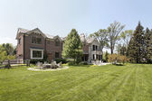 Large brick home and back yard — Stock fotografie