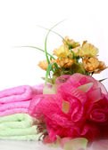 Sponge and a bouquet of flowers — Stock Photo