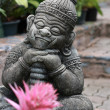 Stone statue in the orchid garden, Thailand — Stock Photo