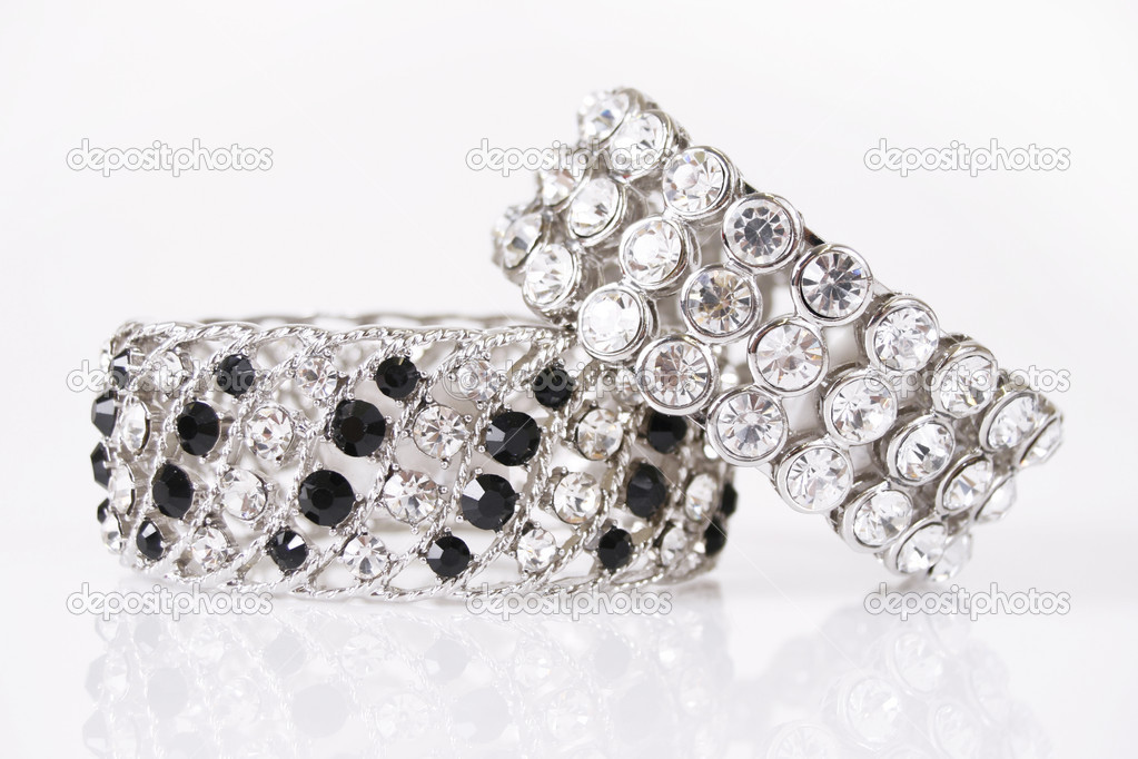 Silver bracelets on a white background — Stock Photo #8788533