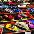 Parking of colorful small model cars - Stock Photo