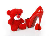 Red teddy bear, heart and shoe — Stock Photo