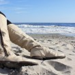 Leather boots on the beach — Stock Photo