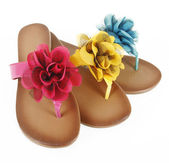 Colored flip-flops with flowers — Stock Photo