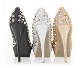 Glitter spiked heels — Stock Photo