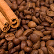 Coffee beans and canella sticks — Stock Photo