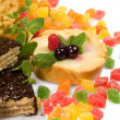 Cake , candied fruit , mint and chocolate — Stock Photo