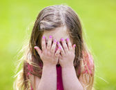Adorable girl playing peek a boo — Stock Photo