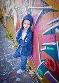 Young boy against graffiti wall — Stock Photo