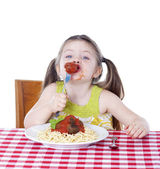 Pretty girl eating pasta and meatballs — Stock Photo