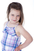 Pretty young girl with hands on hips — Stock Photo