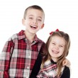 Siblings embracing in holiday clothes — Stock Photo