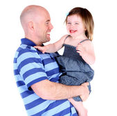 Handsome father laughing with beautiful daughter — Stock Photo
