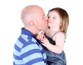 Handsome father kissing toddler daughter on the cheek — Stock Photo
