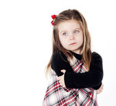 Young pretty girl in a dress on white background with arms folde — Stock Photo