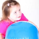 Toddler girl holding a beach ball — Stock Photo