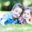 Two children laying in the grass — Stock Photo