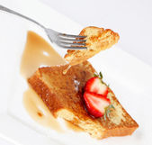 French toast with drip of syrup and strawberries on white backgr — Stock Photo