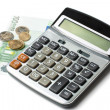 Calculator, coins and hundred euro bill — Stock Photo #9254223