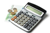 Calculator, coins and a hundred euro bill — Stock Photo