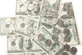 Dollar bills and coins — Stock Photo