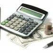 Dollars, calculator, open diary and pen — Stock Photo #9845585
