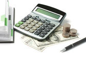 Dollars, calculator, open diary and pen — Stock Photo